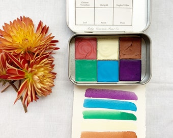 The Rosebud Palette.  A handmade watercolor paint set featuring 6 colors in a travel tin