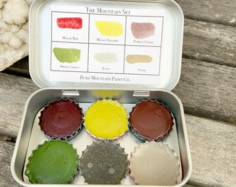 The Mountain Set, a palette of 6 colors of handmade watercolor paint in a new tin