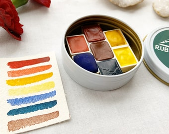 The Primaries, a set of 7 colors of handmade watercolor paint in a new tin