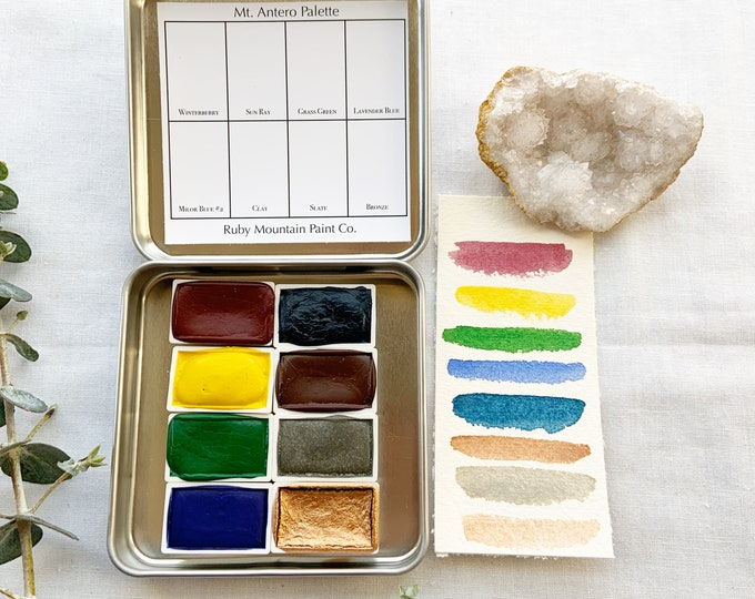 Featured listing image: The Mt. Antero Palette, a set of 8 colors of handmade watercolor paint in a new tin