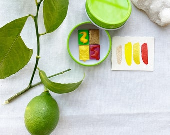The Juicy Citrus Mini Palette, a warm and bright little palette of four handmade watercolors in a new tin