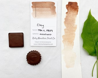 Clay. Half pan, full pan or bottle cap of handmade watercolor paint