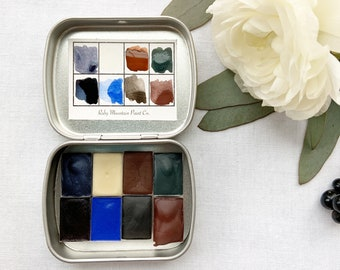 The Winter Traveler's Palette, a mini palette of handmade watercolors in a new travel tin