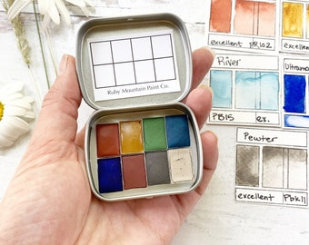 The Late Summer Traveler's Palette, a handmade watercolor palette in a new tin