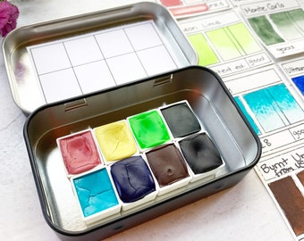 Mountain Meadows Palette, a set of 8 colors of handmade watercolor paint in a new black tin