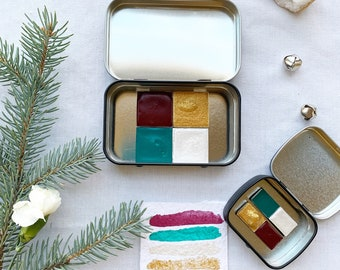 The Classic Christmas Set, a palette of 4 colors of handmade watercolor paint in a new tin