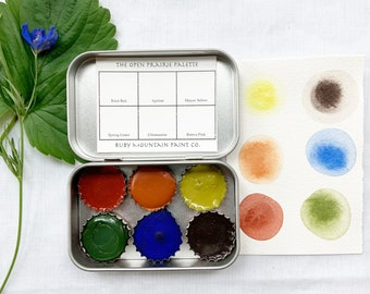 The Open Prairie Set, a palette of 6 colors of handmade watercolor paint in a new tin