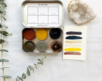 The Mt. Yale Palette , a set of 6 colors of handmade watercolor paint in a new tin