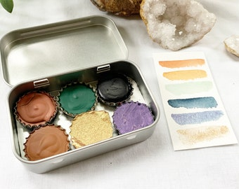 The Darkstar Set, a palette of 6 colors of handmade watercolor paint in a new tin