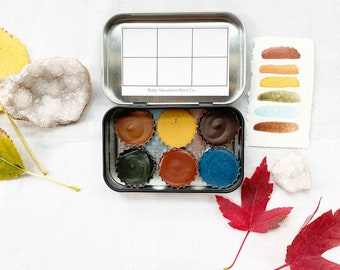 The Autumn Forest Palette, a set of 6 colors of handmade watercolor paint in a new tin
