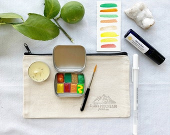 The Chill Out Citrus Gift Set, a warm and sunny gift set with essential oils, watercolors and more for your favorite artist