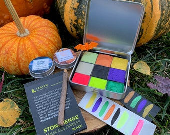 Witches' Brew Palette, a set of Halloween-inspired handmade watercolor paint in a new tin