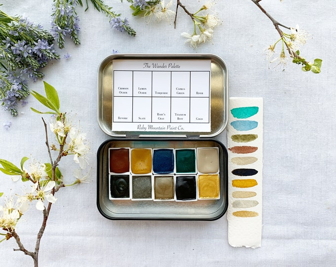 Featured listing image: The Wander Palette, a set of 10 colors of handmade watercolor paint in a new tin