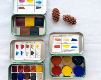 The Secret Stash Collection, primary palettes of handmade watercolors in new tins