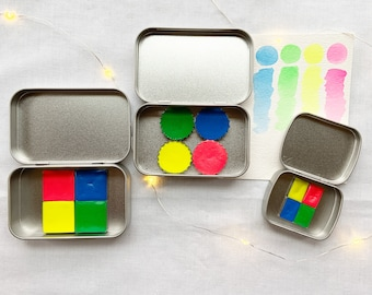 The Party Time 4 Set, a set of 4 colors of handmade watercolor paint in a new tin