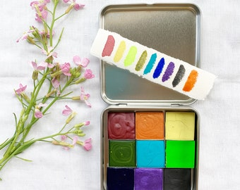 The June Palette, a set of 9 colors of handmade watercolor paint in a new tin