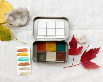 The Golden Plains Set, a palette of 6 colors of handmade watercolor paint in a new tin