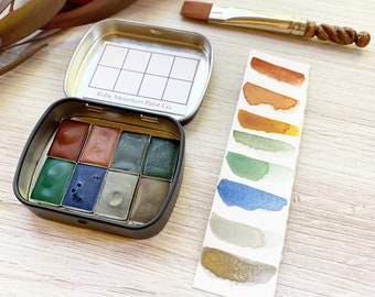 The Early Autumn Traveler's Palette, a handmade watercolor palette in a new tin