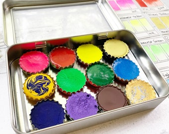The Dog Days of Summer Palette, a unique set of handmade watercolors in a tin
