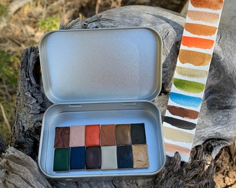 The Queen's Garden Palette, a handmade watercolor palette in a new tin