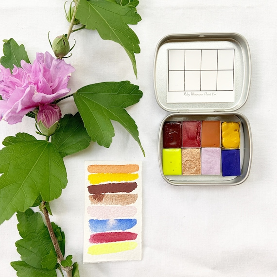 Sunset Skies: A Traveler's Palette of handmade watercolors in a new travel tin
