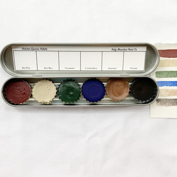The Autumn Equinox Palette, a set of 6 colors of handmade watercolor paint in a new tin