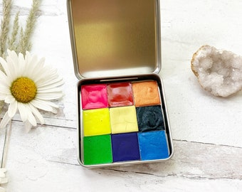 The Carnival Palette, a handmade watercolor palette in a new tin