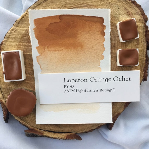 Luberon Orange Ocher. Half pan, full pan or bottle cap of handmade watercolor paint