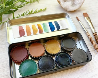 Harvest Moon Palette, a set of 8 colors of handmade watercolor paint in a new black tin