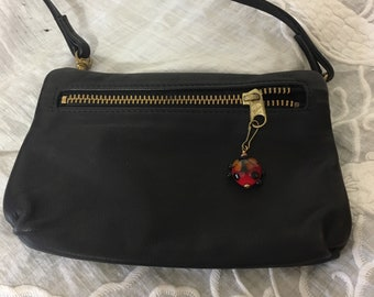 Vintage Handbag.CLEARANCE SALEClearance SaleBronze Metallic Leather Clutch with Tassel Zipper Pull Cross Body
