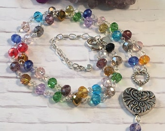 Crystal necklace with heart and crystal pendant; hand beaded rosary-style chain of multi-colored crystals
