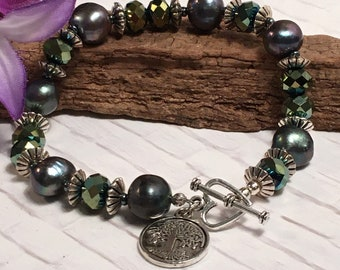Monochromatic freshwater pearl and crystal bracelets with heart toggle and tree of life charm; 3 colors
