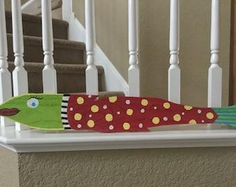 Fun and funky hand painted fish using recycled pallets