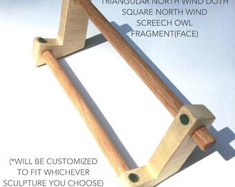 Wooden stand for garden sculpture