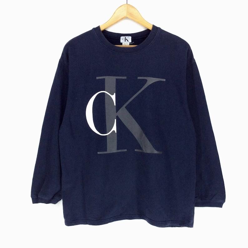 ca3582f06b757 Vintage Calvin Klein Sweatshirt Medium Size Made In Peru Pullover Jumper  Big Logo Spell out Retro Style Rap Tees Hip Hop Swag