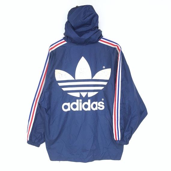 a02b9760f0efc Vintage Adidas Windbreaker Jacket Big Logo Spellout   Adidas   Etsy