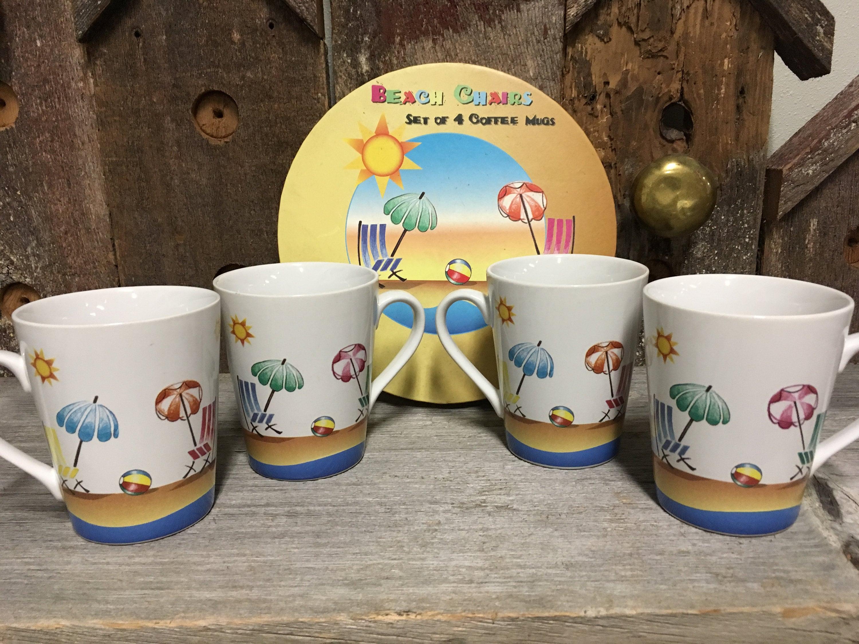 A set of 4 Coffee Mugs by I Godinger Beach