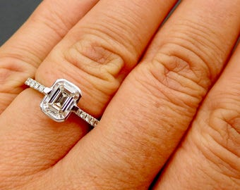 Emerald cut diamond engagement ring, 1ct emerald cut diamond, 18ct white gold and solitaire emerald cut diamond ring with pave set shoulders