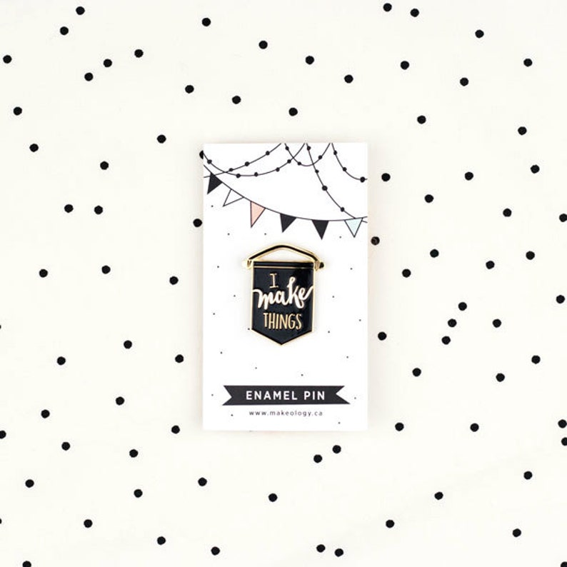 Enamel pin in black lapel pin banner I make things