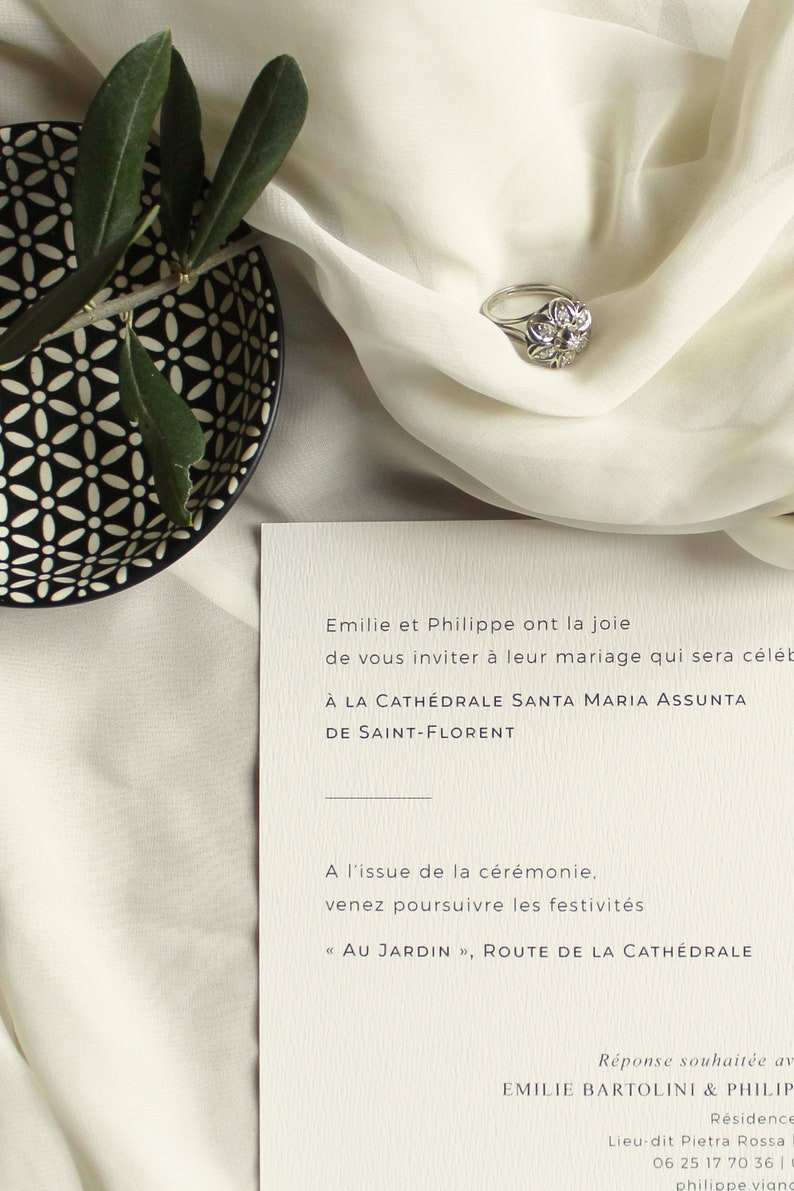 Wedding invitation with olive branch printed on vellum paper