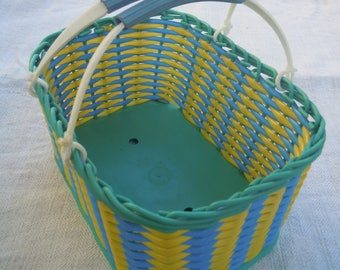 Wicker basket. Woven plastic basket in the Ukrainian style. Picnic basket.