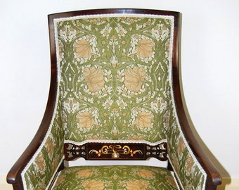 Antique upholstered Edwardian period Art Nouveau armchair inlaid in different metals
