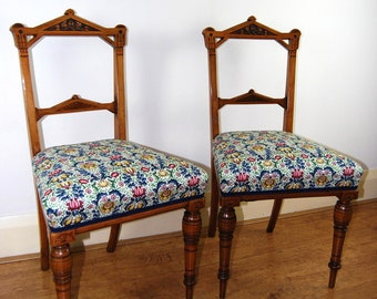 Antique upholstered pair of Victorian Aesthetic Movement walnut side chairs