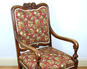 Antique upholstered 19th century carved solid oak armchair / library chair