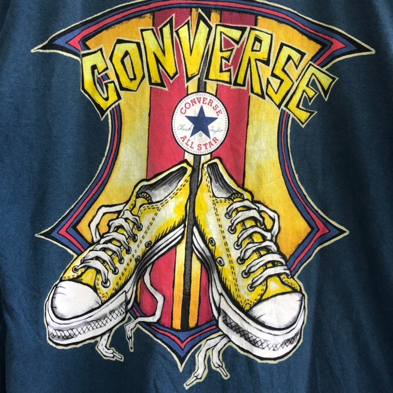 922b8ce93b0e6 Vintage 90s Converse All Star Shoes Long Sleeve T Shirt || Converse started  making an early basketball shoe in 1917 and redesigned it in 192