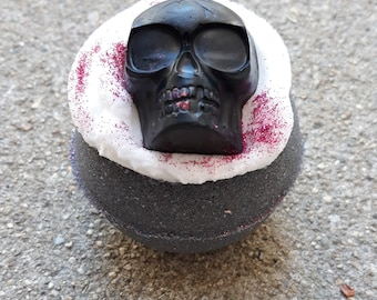 Halloween bath bomb with bubble frosting and soap skull