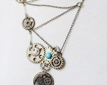 Steampunk necklace asymmetrically zig-zag chained handmade of antique bronze chain, gears and glass rhinestones