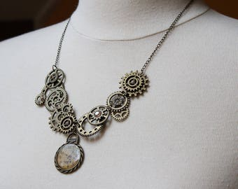 Vintage look steampunk necklace in antique bronze color, with gears and watch dial handmade