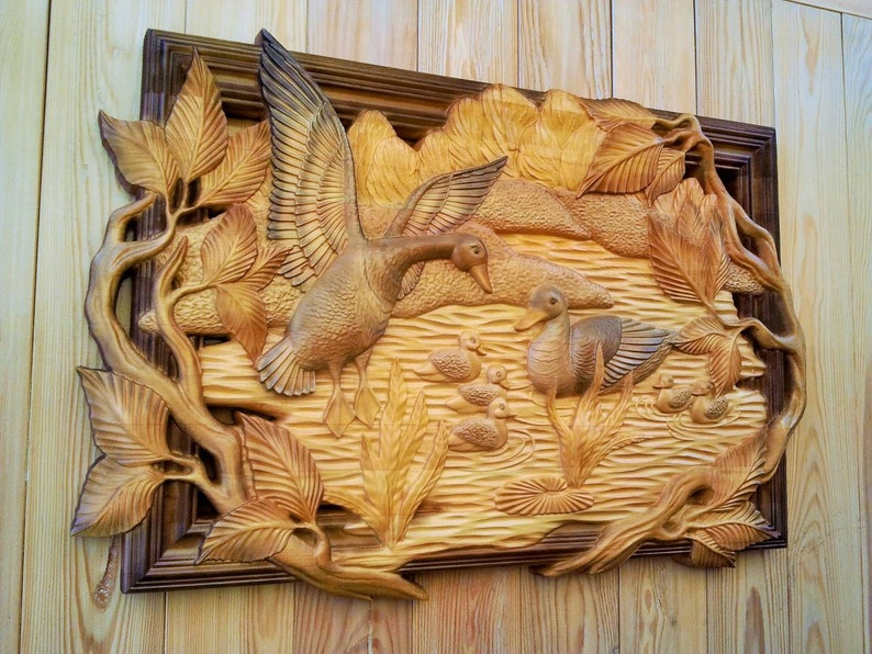 Animals bat with spread wings relief carving on the facade of
