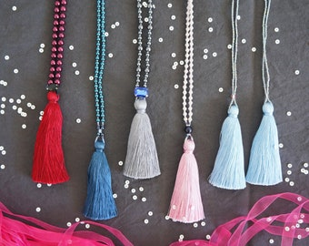 Tassel necklace made with glass pearl